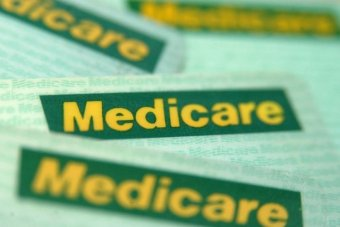 A group of Medicare sit on a table