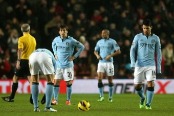 David Silva and Sergio Aguero look dejected after Manchester City concede against Southampton.
