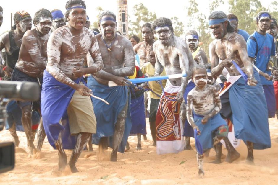 Dancers from the Blue Mud Bay region of north-east Arnhem Land sing in celebration at the annual Garma Festival of Traditional Culture. Image Credit: ABC https://i2.wp.com/www.abc.net.au/news/image/475930-3x2-940x627.jpg