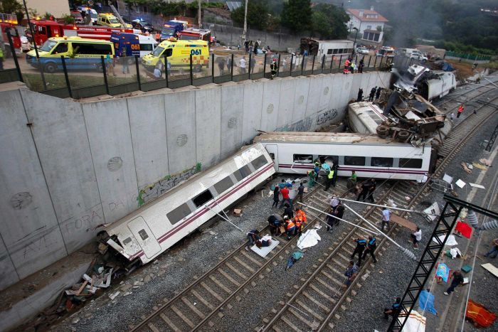 Rescuers work at the scene of a train crash near Santiago de Compostela.