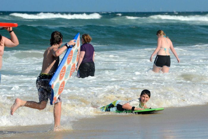 Beachgoers escape the heat at Main Beach on the Gold Coast.
