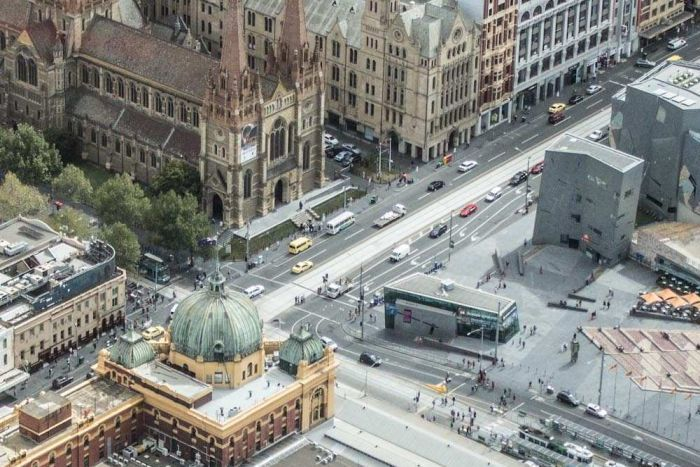 Aerial shot showing Melbourne's Flinders St Station, Federation Square and St Pauls Cathedral