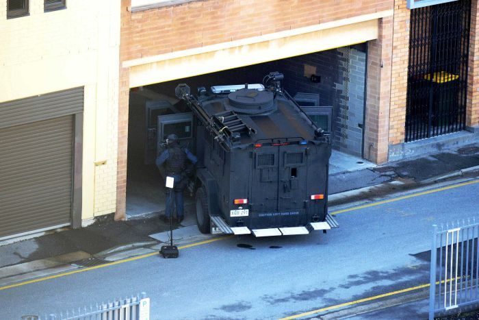South Australian police stand guard during a siege involving fugitive Rodney Ian Clavell.