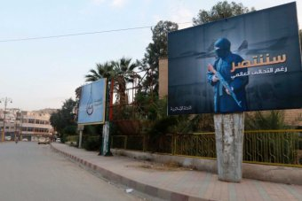 islamic state militants set up billboards in syria declaring victory against coalition