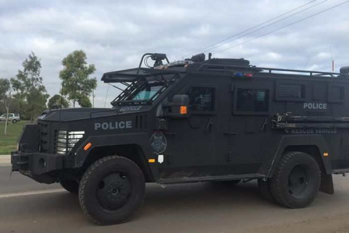 Heavily armed riot police carrying shields are attending a demonstration at the Metropolitan Remand Centre in Ravenhall.