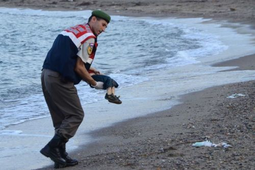 Dead toddler carried from water
