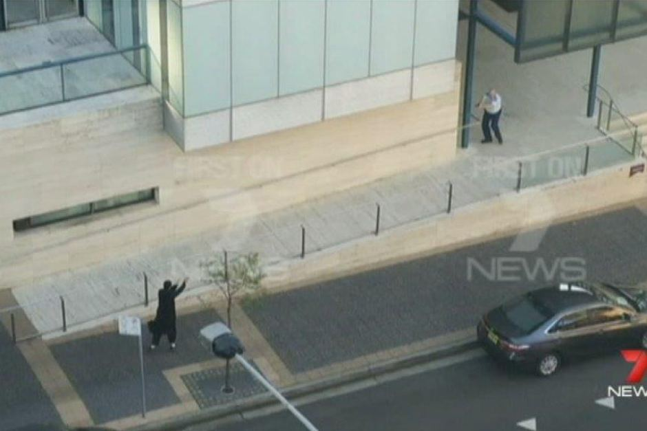 Farhad Jabar Khalil Mohammad and a police officer exchange fire outside the NSW Police headquarters.