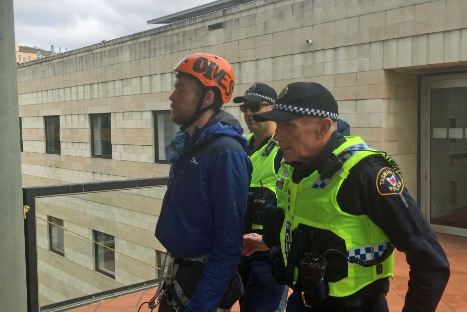 Rooftop protester Brodie Jeavons arrested by Tasmania Police