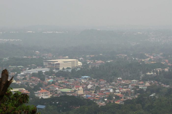 Thick haze from Indonesia's forest fires blankets the city of Davao, southern Philippines