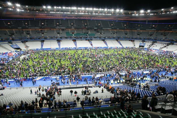 Spectators flock to the pitch on Stade de France