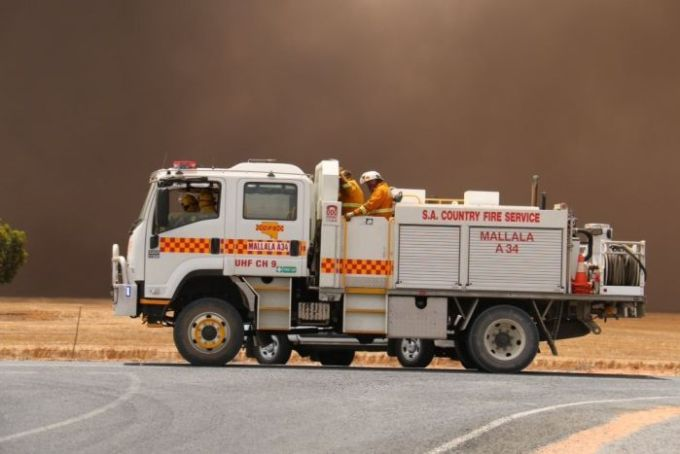 Fire unit drives near thick smoke of a blaze in the Mallala area