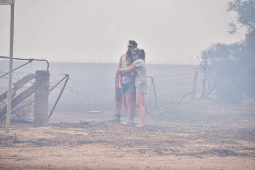 Residents watch their house burn at Wasleys in a big bushfire north of Adelaide