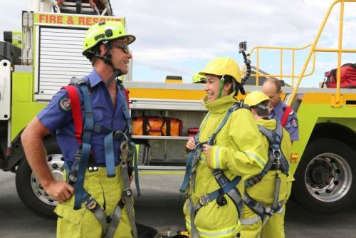 ABC News Canberra journalist Alkira Reinfrank learning safety instructions with ACT Fire and Rescue.