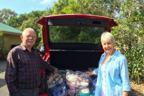 Coral Hallinan (right) and one of the volunteers help pack the handmade teddy bears.