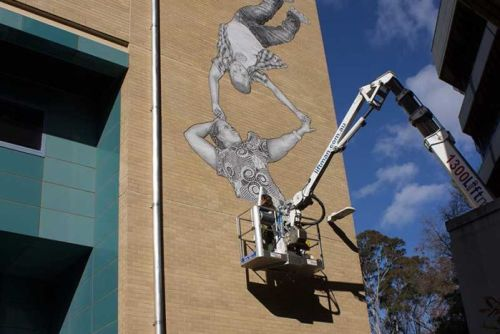 Baby Guerrilla at work on a mural at Victoria University