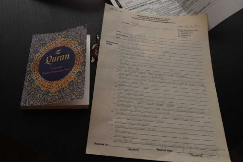 A copy of the Koran and a list of items seized by the FBI in Syed Farook's home