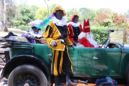 Three men wore traditional Black Pete dress at the Dutch Embassy.