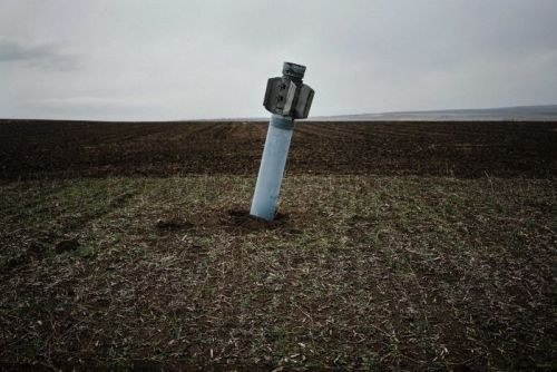 An unexploded rocket in field near the village of Dmitrivka.