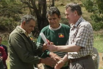 Premier Ray Groom hands over land deed in 1995