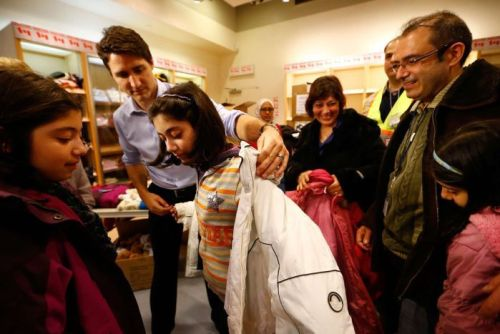 Canada's prime minister helps young Syrian refugee with jacket