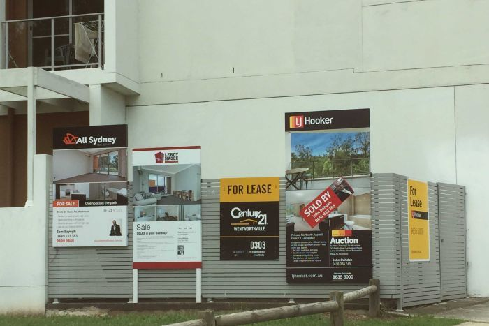 For lease and for sale signs proliferate outside an apartment block in the western Sydney suburb of Westmead