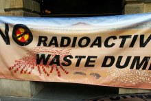 A banner opposing a proposed nuclear waste dump unfurled at the Adelaide Town Hall