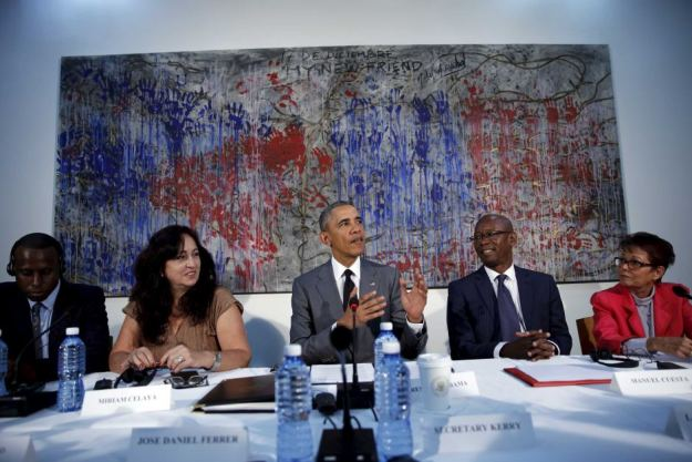 Barack Obama sits at a table with a group of Cuban dissidents.