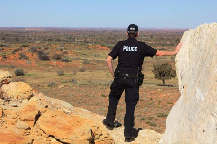 NT Police officer in remote location generic image.
