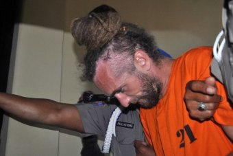 Police take British man David Taylor being taken from his holding cell in Bali