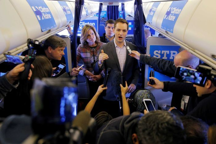 Robby Mook, Campaign manager for US Democratic presidential nominee Hillary Clinton talks to reports onboard the campaign plane en route to cedar rapids, October 29, 2016.