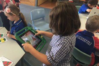 A Prep student at Oakleigh State School on an iPad