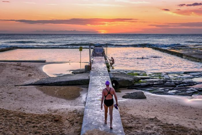 The sun rising over the ocean and sea baths at Austinmer, NSW