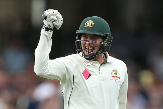 Matt Renshaw raises his fist in triumph after maiden ton