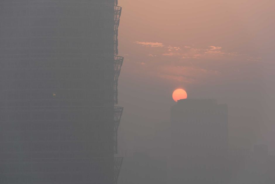 The sunset is seen through smog in Zhengzhou in the Henan province of China.