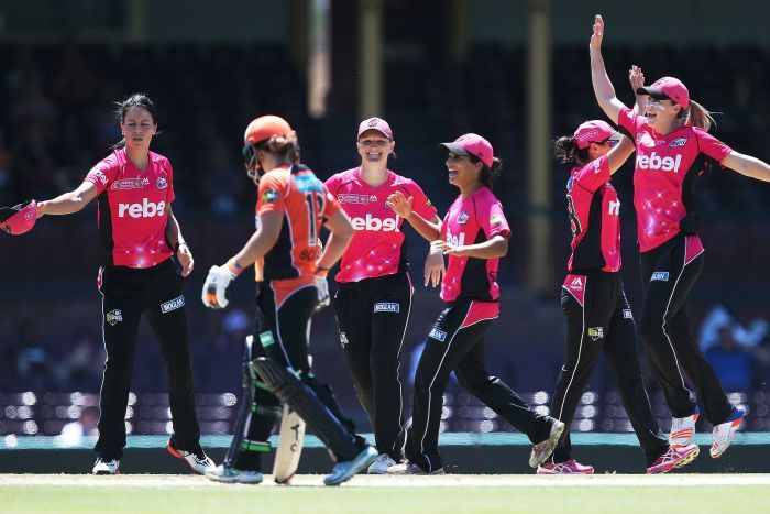 Sydney Sixers players celebrate after Perth Scorchers' Elyse Villani is dismissed in 2016/17 WBBL.