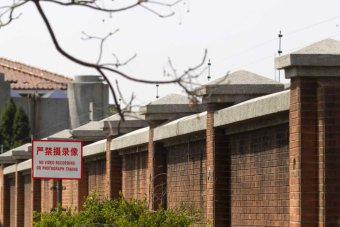 A warning sign is seen outside the Shanghai No.1 Detention Center.