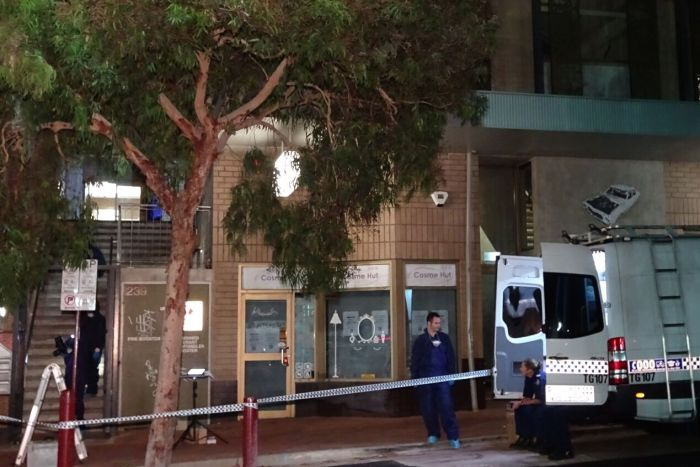 Forensic police search an apartment