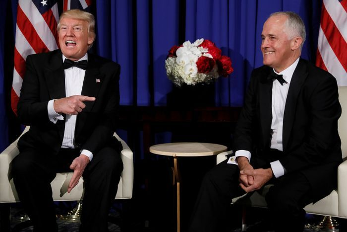 Donald Trump laughs and points towards Malcolm Turnbull during a meeting ahead of Coral Sea 75th anniversary commemorations.