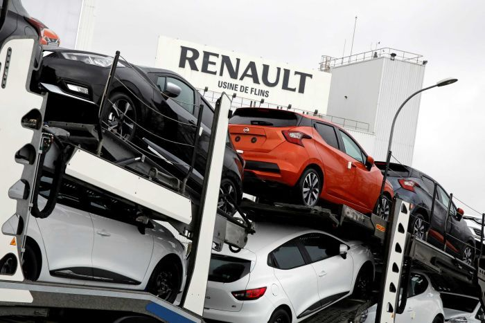 New Renault and Nissan automobiles are loaded onto a transporter at the Renault SA car factory in Flins, France.