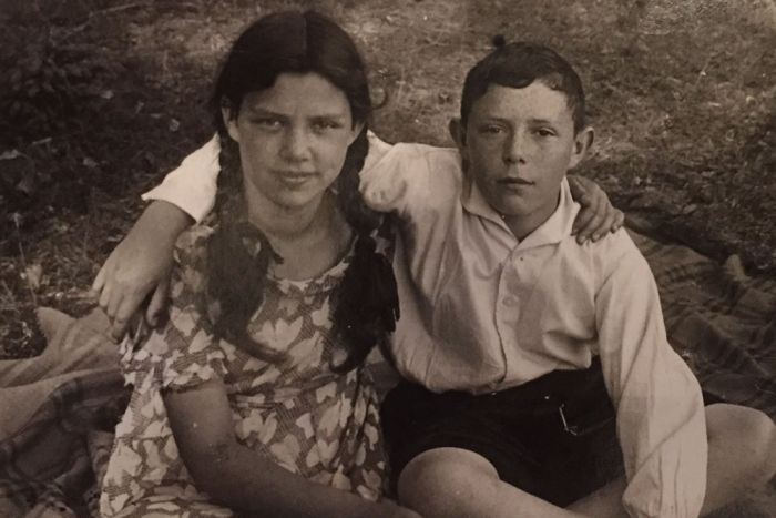 Bella and Phillip with their arms around any other in Poland in 1929.