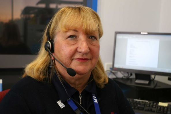 Mental health nurse Glynis Thorp has her headset on for talking to patients over the phone