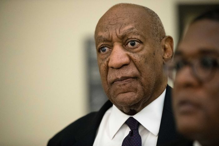 Bill Cosby returns to the courtroom during a break on the second day of his sexual assault trial.