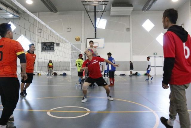 A player eyes a ball over his head.