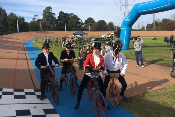 Charlie Farren (centre) begins a race of replica vintage cycles around the Brunswick velodrome.
