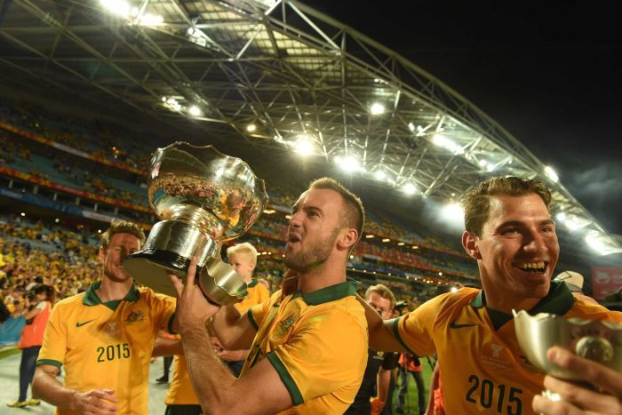 Socceroos celebrate their win over Sth Korea in the Asian Cup final