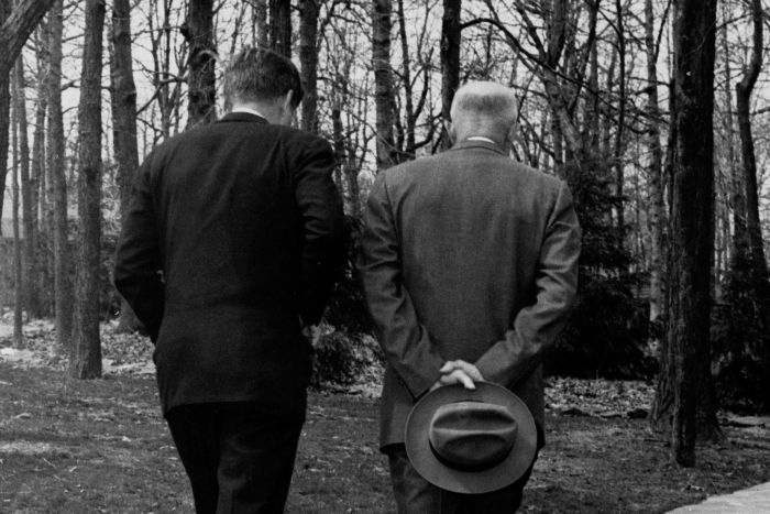 John F Kennedy and Dwight D Eisenhower walk up a path at Camp David.