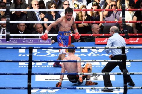 Jeff Horn (bottom) falls to the ground against Manny Pacquiao.