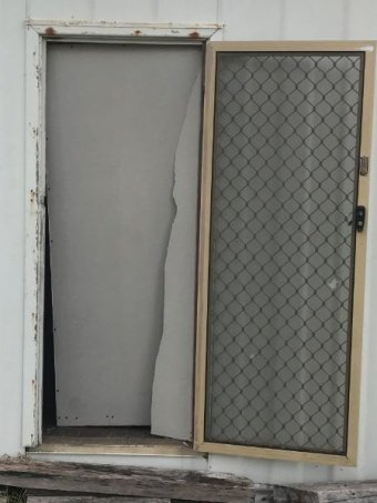 Image of a front door from a house damaged by an alleged burglar in Esperance.