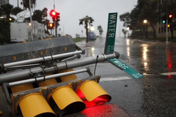 Traffic lights lie on a street after being knocked down,