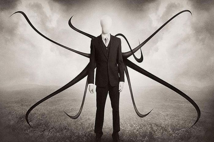 A drawing of the Slender Man character, in a suit with tentacles coming from his back.